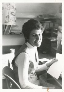 middle aged woman at a typewriter
