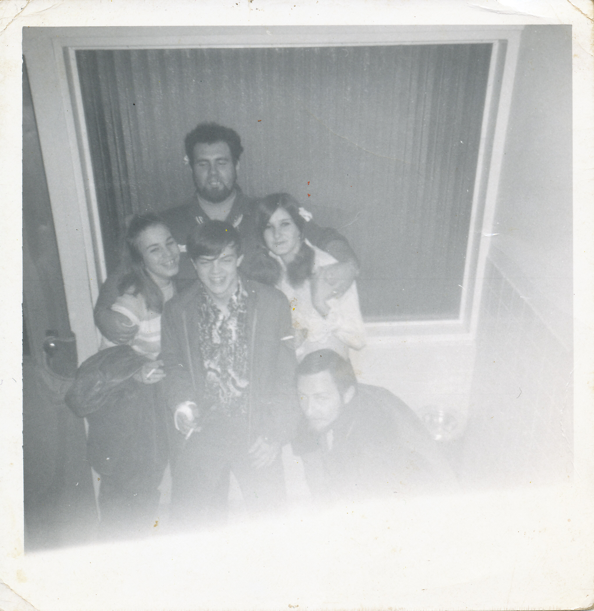 group shot of 2 young girls, one young boy and 2 older young men