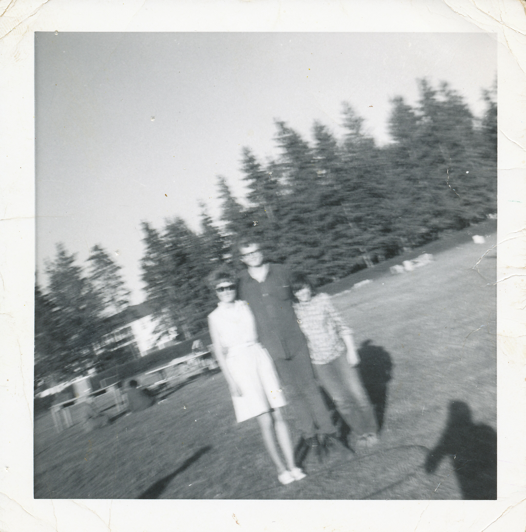 2 young women and one young man standing in playing fields