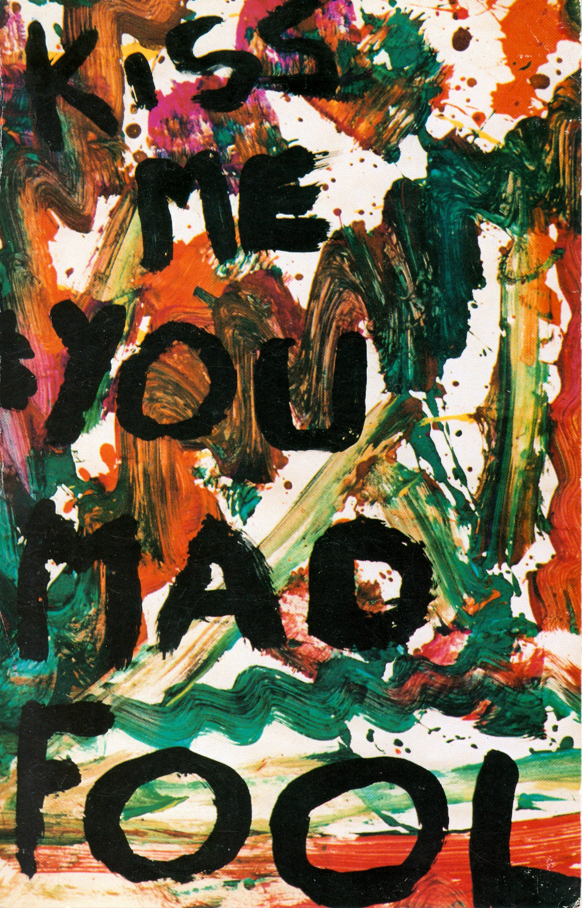"""a book cover decorated with splashes of green, red, orange and yellow with the words """"Kiss Me You Mad Fool"""" painted on top"""