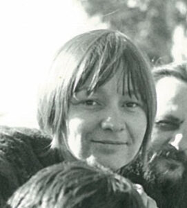 smiling young woman with bangs and short hair