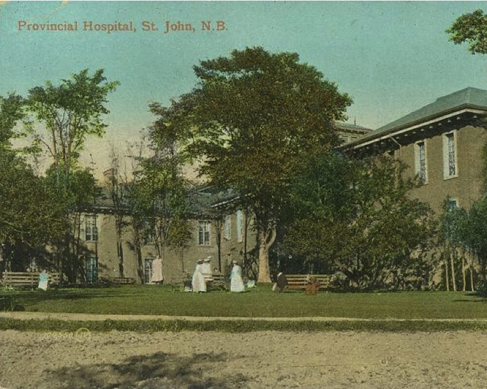 old building with woman wearing white dresses on grass
