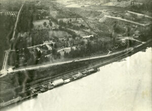 aerial photos of large institution and body of water from a tilted angle