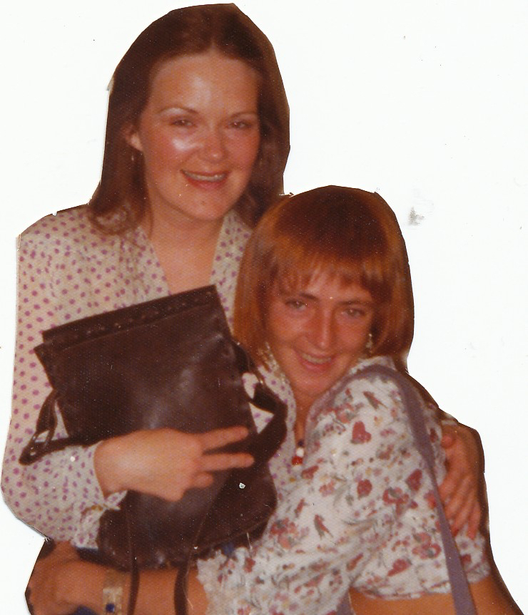two women with their arms around each other