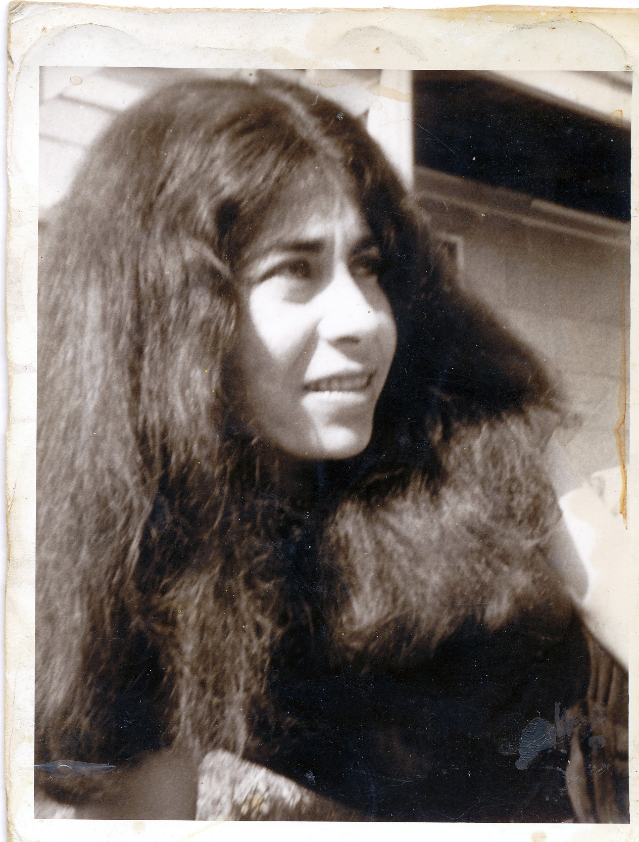 head and shoulders of young woman with mass of long dark hair