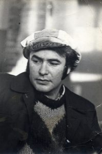 man with pea coat and sweater