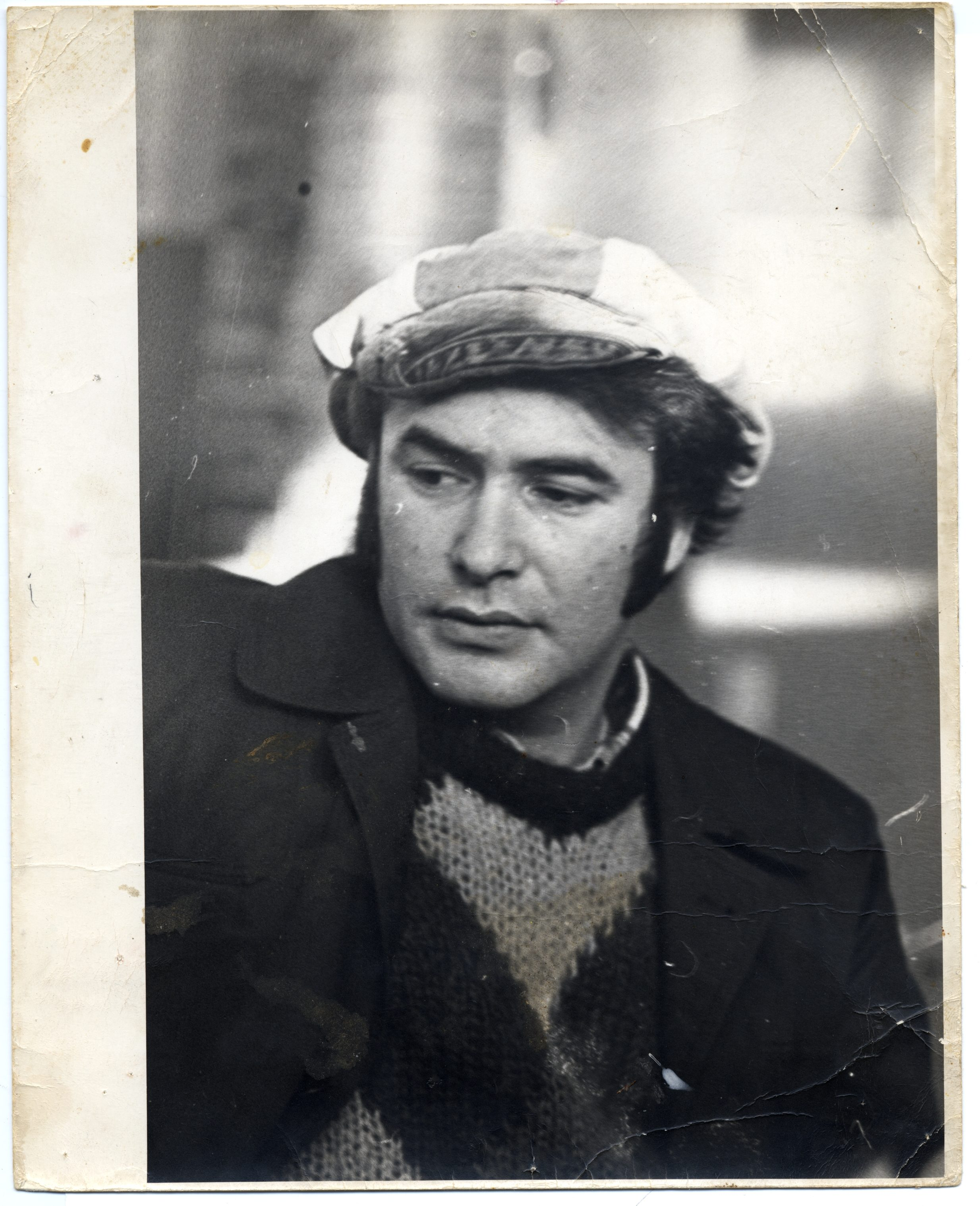 man with peat coat and hat
