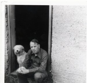 man and dog sitting on door step
