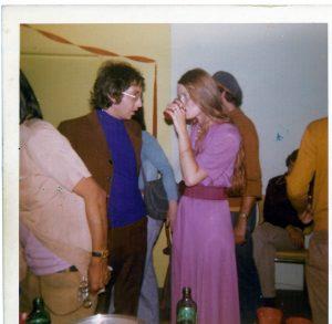 man and woman talking at a party