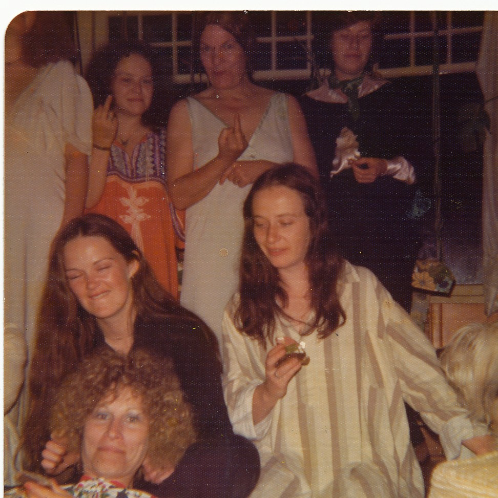 group of women all dressed in nightclothes and having a good time