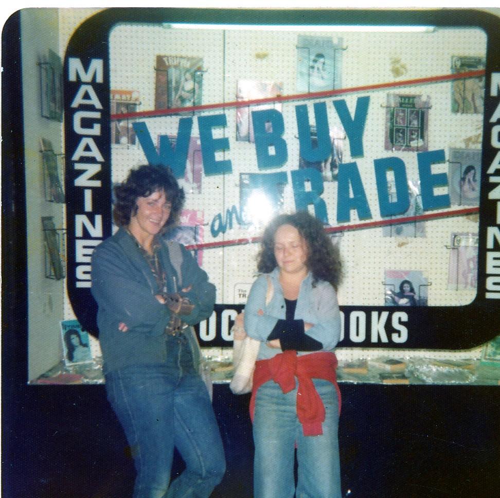 2 women standing outside department display window