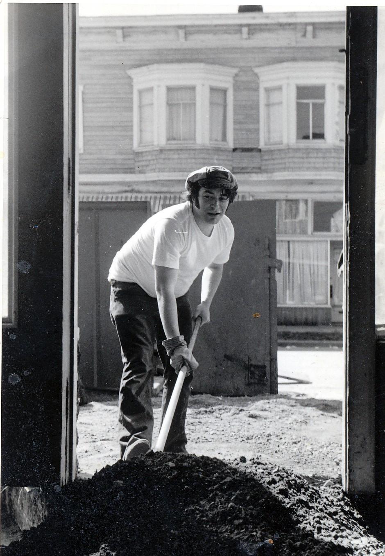 man with shovel digging pile of dirt