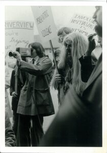 1970s protesters and media film crew